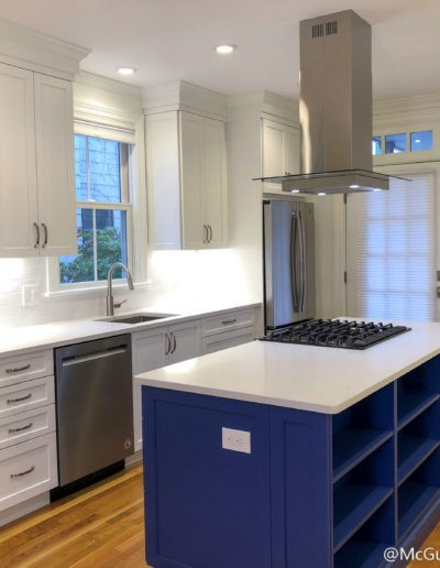 Cambridge Condo Remodel - White Kitchen Cabinets with Blue Island