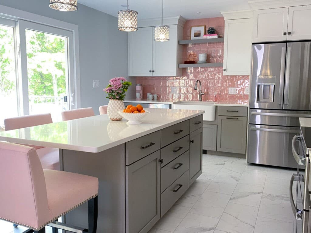 Pink Backsplash Kitchen Remodel with Gray and White Cabinetry